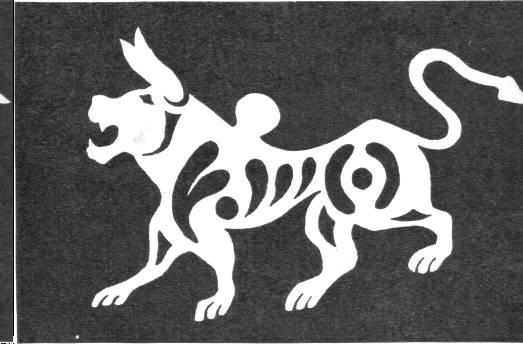 Лев, вырезанный из коры и покрытый оловянной фольгой